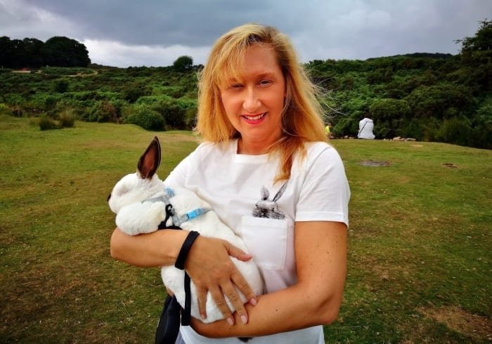 rachel de jong holding her pet rabbit speedy